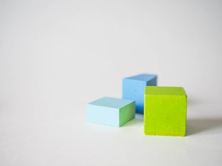 colored childrens cubes lie on a white background