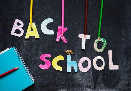 the writing paper back to school on chalk blackboard background Banco de Imagens