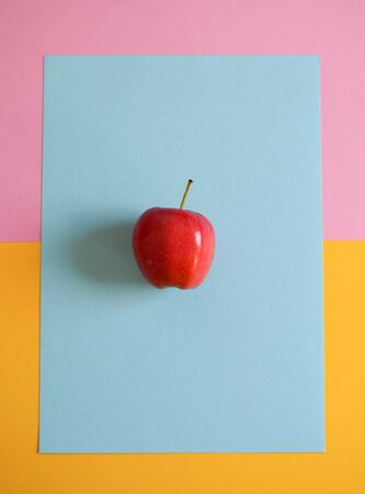 an Apple on a colored background