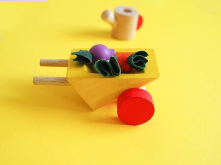 wooden toy vegetables on a colored background concept Banco de Imagens