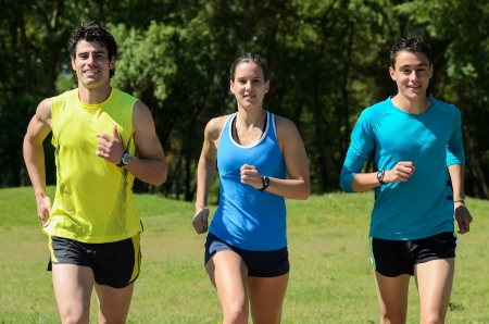 Young runners training in a park  Stock Photo