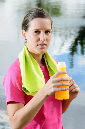 isotonic: Young female athlete drinking isotonic drink for rehydratation and recover nutrients  Stock Photo