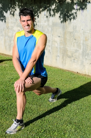 Sportsman stretching and smiling in summer day in park. Stock Photo - 14301144