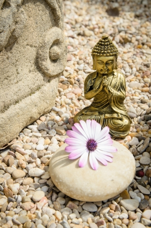 Ancient, spiritual style photo with Buddha , altar and flower  photo