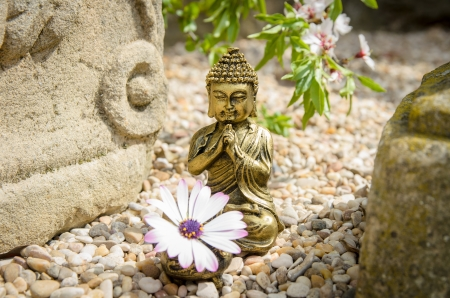 stone buddha: Ancient, spiritual style photo with Buddha , altar and flower