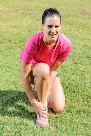ankle: Woman feeling pain because an ankle sprain while she was running