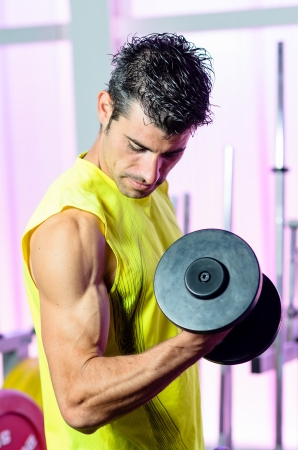 Biceps exercise with weights in Gym. photo