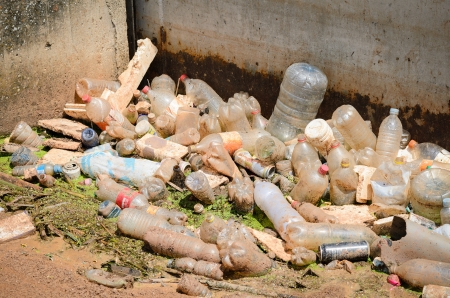 trashy: Plastic bottles, cans of soda and other trash floating in a toxic river