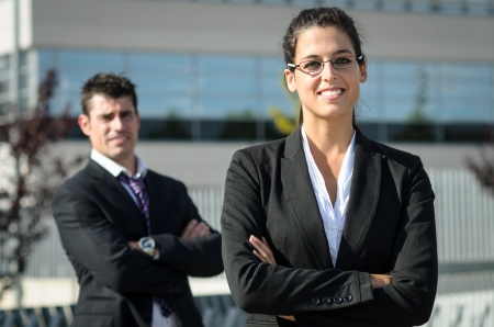 self confidence: Idly business people smiling with self confidence attitude