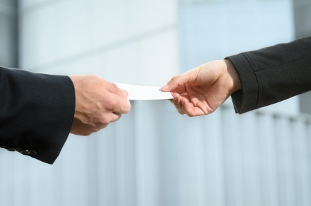 businesscard: Detail of hands exchanging business cards Stock Photo
