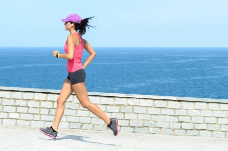 Beautiful woman running with blue sea on the background