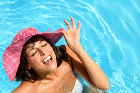 Happy face of beautiful brunette woman in swimming pool Stock Photo - 15370112