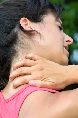 Woman with neck pain touching her cervical. Stock Photo - 16037251