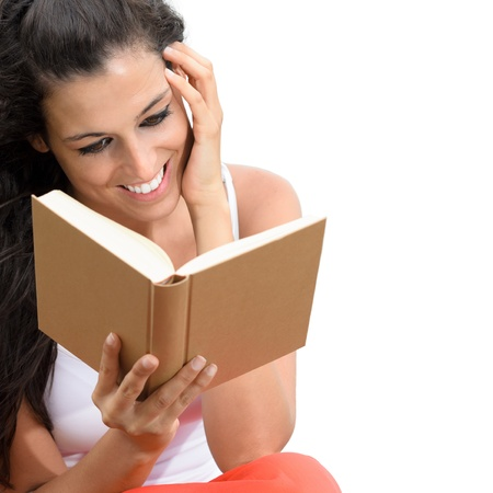 woman reading: Charming woman reading a book. She touches her face with her hand with dreamy romance looking. Isolated on white.