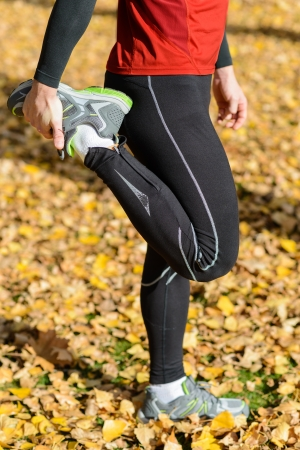 quadriceps: Unrecognizable male athlete stretching leg quadriceps outside. Stock Photo