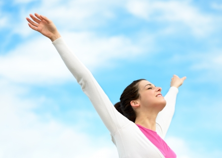 outstretched arms: Woman with arms up raised to sky on spring Stock Photo