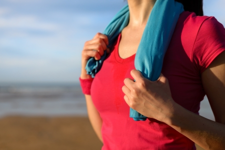 sweaty: Sport, running and exercising concept. on beach in summer. Fitness sweaty woman with sport towel in healthy lifestyle background. Copy space. Stock Photo