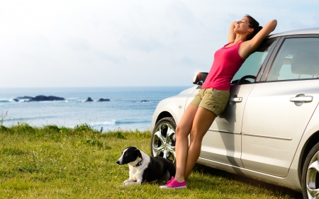 Happy woman and dog enjoying travel and peace on summer
