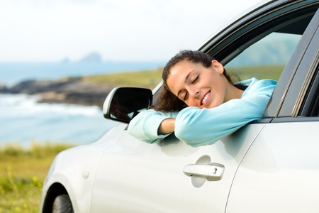 Woman in car travel relaxing and enjoying peace and silence of beautiful summer coast nature landscape photo