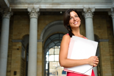 higher education: Happy female student in european college campus  Higher education successful woman  Universidad Laboral, Gijon, Asturias, Spain  Girl on classic university indoor