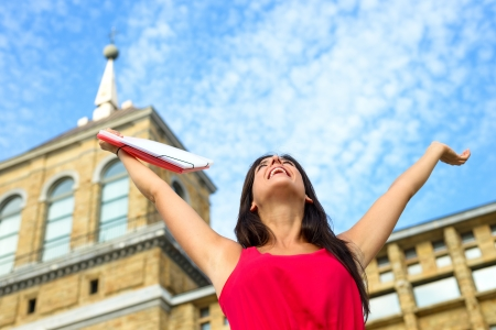 Blissful female student in european college campus with arms up to the sky  Higher education successful woman  Universidad Laboral, Gijon, Asturias, Spain  Girl on university  Stock Photo