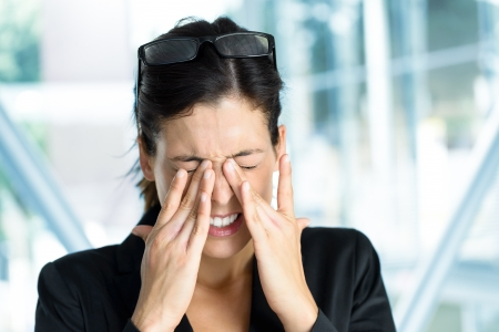 sore eye: Exhausted and tired eyes business executive woman. Businesswoman stress and problems in job. Stock Photo