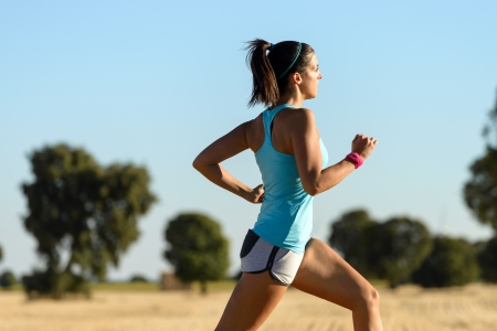 Trail running in country side  Woman runner sprinting and training for cross race  Fitness girl exercising on summer rural landscape  Stock Photo