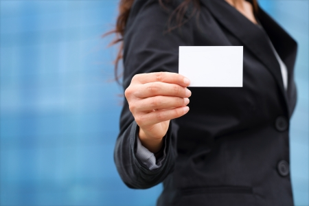 Businesswoman showing white empty business card  photo