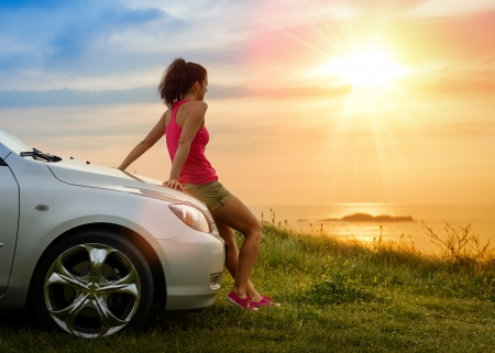 people   lifestyle: Female driver enjoying freedom and beautiful sunshine over the sea after driving to coast in summer vacation travel. Woman relaxing and taking a break to enjoy the scenery.