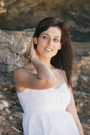 fair skinned: Natural woman summer portrait without makeup  Relaxed brunette female outdoor wearing white dress  Stock Photo