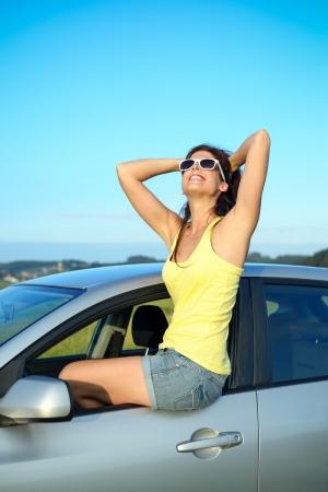 blissful: Happy woman enjoying summer vacation on car travel  Blissful female driver portrait  Stock Photo