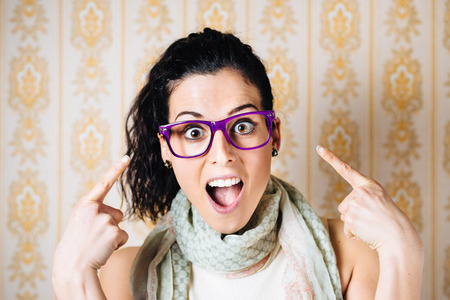 Funny woman wearing glasses  Happy surprised girl pointing her eyewear