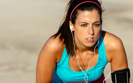 Tired female runner resting and taking a break. Motivated sporty woman exhausted after running. Stock Photo - 27334007