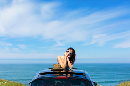 Relaxed tranquil woman on summer travel vacation to the coast   Standard-Bild