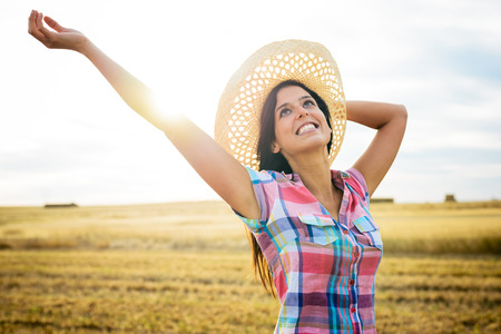 blissful: Blissful female farmer enjoying success and freedom in countryside field  Successful agriculture farm business concept