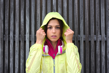 healthy looking: Female athlete getting ready for urban workout Brunette sporty woman looking at camera  Motivation and fitness healthy lifestyle concept  Stock Photo