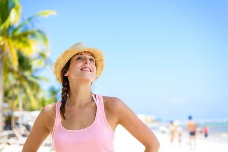 riviera maya: Relaxed cheerful woman enjoying tropical caribbean vacation at the beach in Playa del Carmen, Riviera Maya, Mexico.