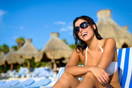 mayan riviera: Joyful woman at tropical resort caribbean beach. Summertime vacation tourism and travel concept. Beautiful brunette sunbathing and relaxing at Mayan Riviera, Mexico.