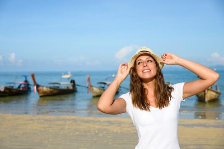 railay: Happy woman enjoying travel vacation at Thailand. Joyful brunette having fun and smiling on Railay Beach, Krabi.