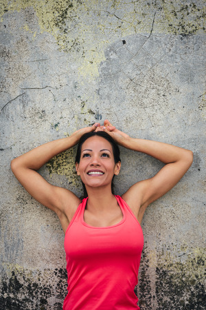 woman looking up: Sporty woman smiling portrait. Success and fitness goals concept. Stock Photo