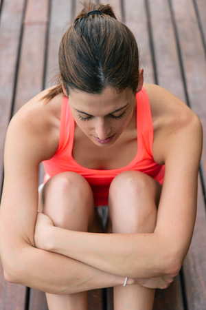 demotivated: Tired or unmotivated sporty woman taking a fitness workout rest.