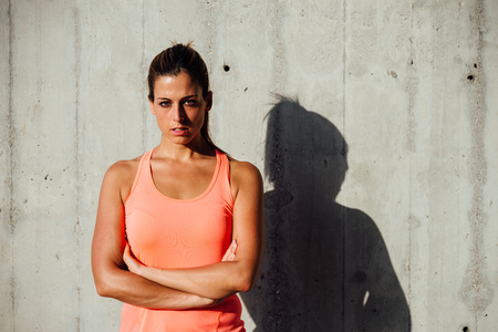 sporty: Confident serious sportswoman portrait. Sporty beautiful woman looking intensely. Motivation and sport  concept.