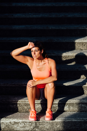 sweaty: Sweaty sporty woman taking a fitness workout rest.  Motivation and healthy lifestyle concept. Stock Photo