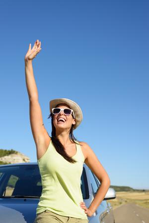 castilla y leon: Happy woman on car roadtrip waving and having fun. Tierra de Campos, Castilla y Leon, Spain. Stock Photo