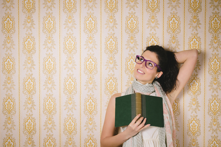 glasses eye: Joyful smart woman reading book and using imagination. Female daydreamer relaxing with lecture.