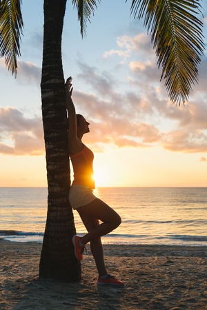 riviera maya: Fitness woman relaxing and resting after morning tropical beach workout at Riviera Maya, Mexico. Travel and vacation relax. Stock Photo