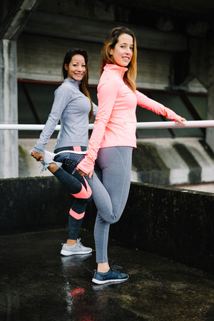 quadriceps: Fitness women stretching legs quadriceps for warm up before working out or running.