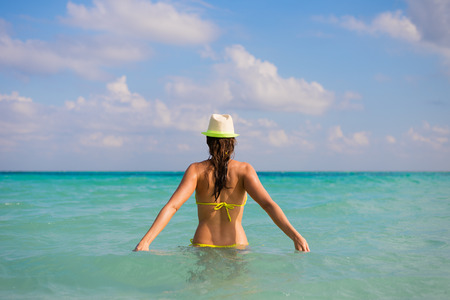 view woman: Back view of young woman on summer caribbean travel and vacation. Stock Photo