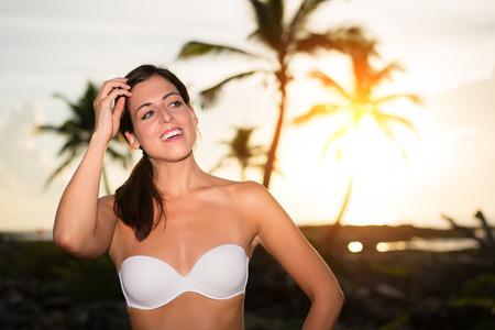 riviera maya: Beautiful happy woman againts the sunrise during tropical caribbean vacation travel to Riviera Maya, Mexico.