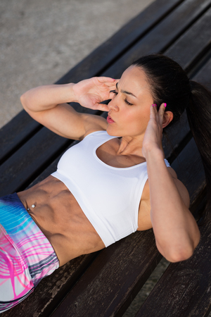 sit ups: Motivated fitness woman doing crunches exercise workout. Female fit athlete training abdominal midsection for  improve core strength.